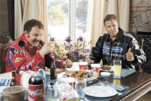 Dumb and dumber: John C. Reilly and Will Ferrell have a Coke and a smile in Talladega Nights: The Ballad of Ricky Bobby.