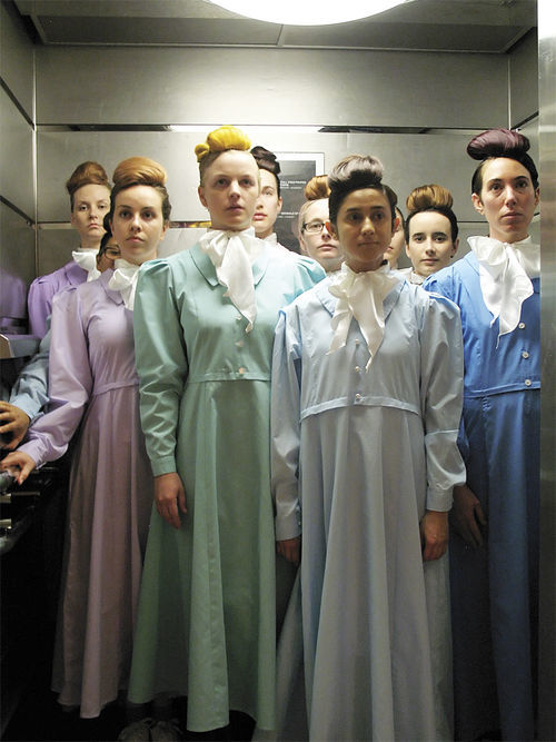 Sister wives stuff an elevator at the Museum of Contemporary Art during the Sydney Biennale.