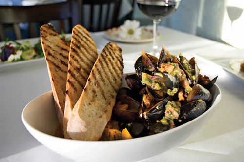Plump, harissa-spiced PEI mussels with chorizo and charred tomato-cilantro vinaigrette will get your mouth watering at House of Tricks, a longtime fave in downtown Tempe.