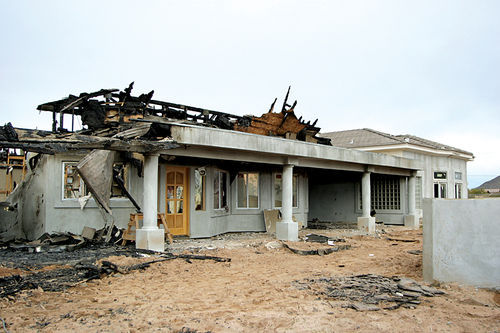 The December 2003 fire destroyed the new home of Peoria residents Betty and Mike Johnson.