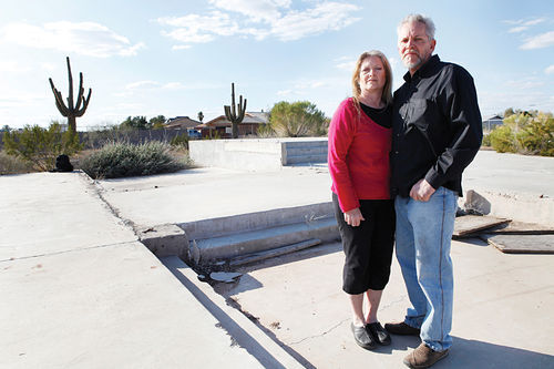 Betty and Mike Johnson at the site of what was supposed to be their dream home.