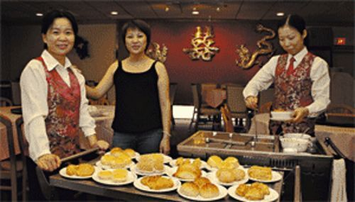 Fit for a queen: Owner Lisa Zhen (center) is the force behind China King.
