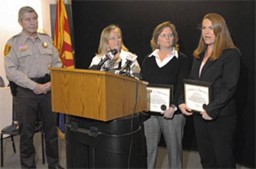 "Yavapai County Sheriff Steve Waugh presents a ""Certificate of Appreciation"" to Julie Bradshaw, left, and two others at the Mingus Springs school for helping unravel the Rodreick case."