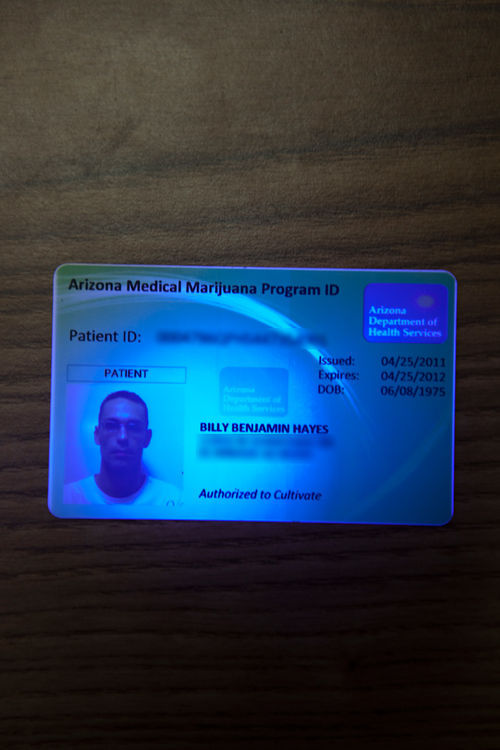 Staff members at the Arizona Compassion Club say they scrutinize carefully medical-marijuana cards (like this one) issued by the state Department of Health Services before helping patients obtain pot.