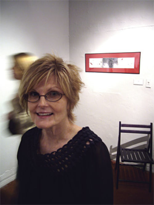 Artist Mary Shindell with one of her $99 paintings at five15.