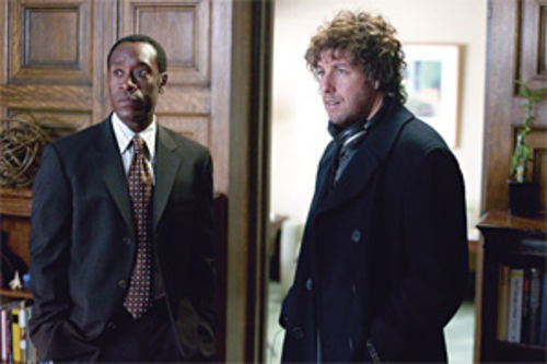 Old buddies Don Cheadle and Adam Sandler are looking for personal saviors in Reign Over Me.