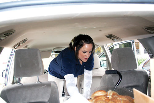 Liz DaCosta delivers turkeys on Thanksgiving Day.