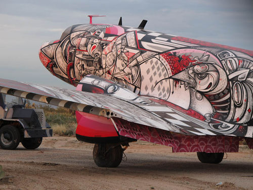 A Super DC-3 planes painted by How & Nosm in the Tucson boneyard