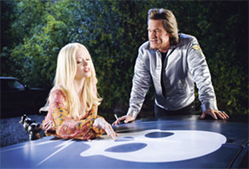 A Rose by any other hair color: A blond McGowan returns, with Kurt Russell, in Grindhouse&Acirc;s second half, Death Proof.