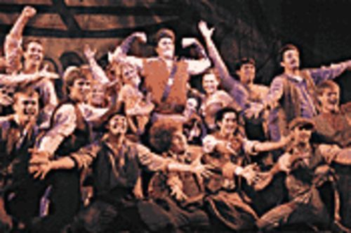Chorus boys galore get gassed up on Gaston in Disney´s Beauty and the Beast.