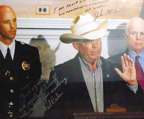 Pinal County Sheriff Paul Babeu (left) presented Dever with this framed photograph last year.