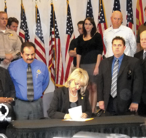 Governor Jan Brewer signing SB 1070  on April 23, 2010, starting a fight she will never win.