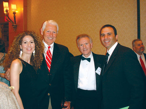 Penzone's wife, Veronica, former University of Arizona basketball coach Lute Olson, an unidentified man, and Penzone.