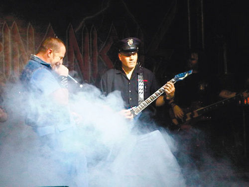 Ex-Phoenix cop George Contreras (performing with his band Blue Steel) was implicated in an off-duty security scandal that also was about to ensnare Sean Drenth.