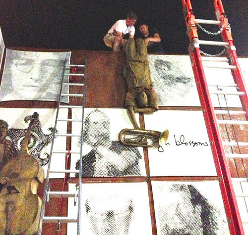 Tonnesen and Hallman, installing statuary at the Tempe Flour Mill late on the night of its grand opening — after the grand opening celebration.