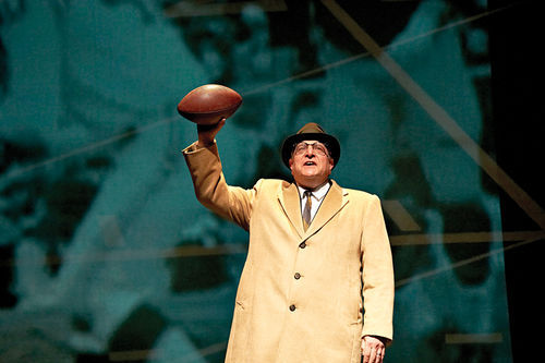 The late Vince Lombardi (and actor Bob Ari) salute the balcony seats.