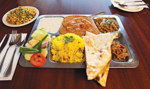 The best way to enjoy many of New India's entrées is as a thali dinner, which includes a daily curry and intensely spicy pickles.