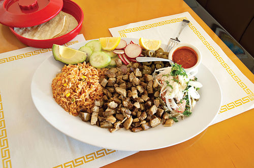 Entrees, like carnitas, are served as heaping plates of traditional favorites.