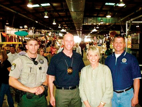 Former PCSO Deputy Hank Mueller (left) with Sheriff Paul Babeu, Governor Jan Brewer, and PCSO spokesman Tim Gaffney.