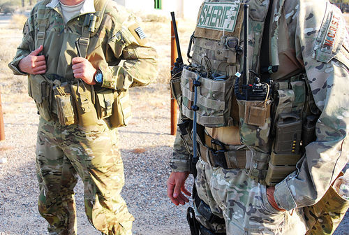 An MCSO drug team dresses up commando-style to look for smugglers in the Vekol Valley.