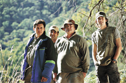 "Guilty party: Left to right, Gabriel Byrne, Stelios Yiakmis, John Howard, and Simon Stone go ""fishing over a dead body"" in Jindabyne."
