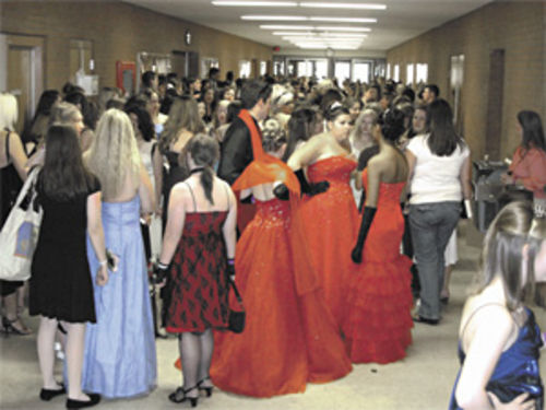 Hundreds of girls line up for Meyer�s promotional prom in May.