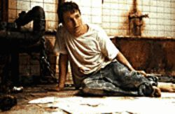 Oh, the horror!: Leigh Whannell sizes up his predicament in Saw.