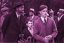 Will Smith (left) as Bagger Vance is the best of the bunch in this movie; J. Michael Moncrief as the kid makes a splendid debut; Matt Damon is just another Redford stand-in.