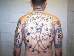 Angel Garcia's back, tattooed with signs of his New Mexican Mafia affiliation