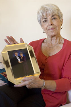 Linda Kilfoy, with a photo of her mother, Cecil, and stepfather, Herm Teague.