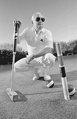 Arizona Croquet Club champion Ren Kraft at home on his court.