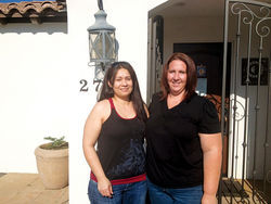 Briseira Torres (left), with friend Amy Diaz, one day after her release from Estrella Jail.