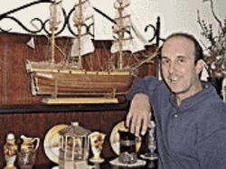Krone, without toupee, with the model ship he built on  Arizona's death row.