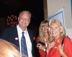 Attorney General Tom Horne with Horne's outreach director, Kathleen Winn (right), at the Arizona Republican Party 2012 election night event at the Hyatt Regency hotel in downtown Phoenix.