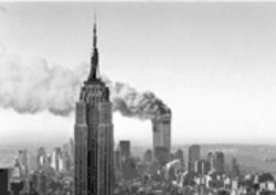 It begins: Smoke billows from the World Trade Center towers.