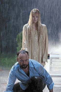 Making waves: Bryce Dallas Howard (top) and Paul Giamatti try to make sense of loony mythology in Lady in the Water.