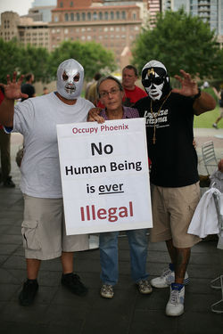 SB 1070 protesters don lucha libre masks at an Occupy Arizona rally.