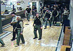 Deputies in full combat regalia at the Mesa public library.