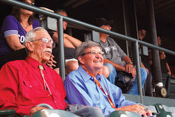 Macumber and Larry Hammond, the founder of the Justice Project, at a Colorado Rockies game.