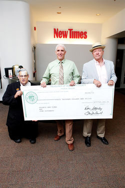 Um, Joe Arpaio himself stops by New Times&#039; offices to present a $40K check to former staff writer and current U.S. Senate candidate John Dougherty (middle) and Village Voice Media Executive Editor Michael Lacey.
