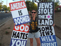 "Sara Phelps, granddaughter of Westboro Baptist Church pastor Fred Phelps, protests ""the Jews"" outside Tempe's Temple Emanuel on September 4."