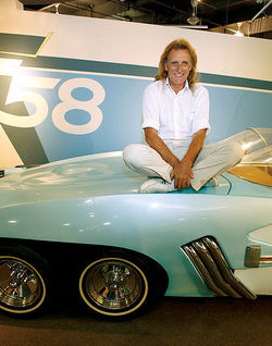 "Richard Fletcher poses with the ""Fletch-O-Rama"" exhibit at the Scottsdale International Auto Museum."