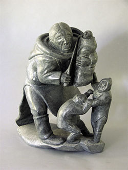 Mother with Fighting Children by Inuit artist Jimmy Inarula Arnamissak, now at Heard Museum.