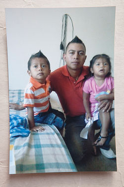 Mauricio Perez holds his son and daughter, Mauricio Jr. and Kimberly.