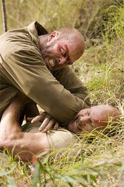 Nathan Jones puts the hurt on Steve Austin in The Condemned. At least one will die, or so they tell us.