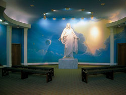 A statue of Jesus Christ welcomes all to the Mesa temple's state-of-the-art visitors center.