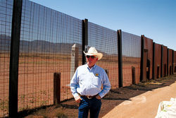 "Cochise County Sheriff Larry Dever at the fence near Naco: ""There are good people coming over here looking for jobs, I understand that. But bad guys are coming in and will continue to come in."""