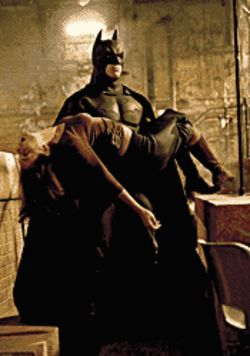 A Dark Knight's tale: Christian Bale (carrying Katie  Holmes) is the latest to don the bat suit in Batman  Begins.
