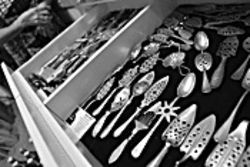 A glittering array of absinthe spoons, from Tucson  author Betina Wittels' collection.