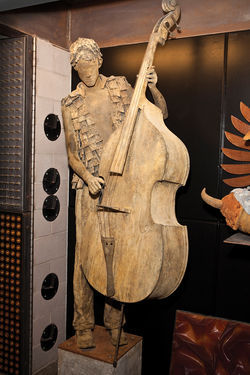 Mill Rat is modeled after the young musicians who play for tips on Mill Avenue. His vest is made of mouse traps.